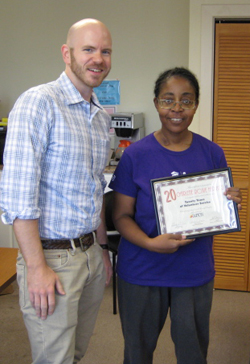 J. Dewey, our Director of Public Relations, presents Roxie with a certificate in honor of her 20 years of volunteer service.