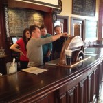 Paul, a manager at the Newburgh Brewing Company, shows our guest bartenders how to work the taps.