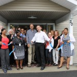 Cutting the blue ribbon at the open house.