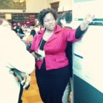 Tiffany Sturdivant-Morrison, CQI Manager, discusses her findings with conference attendees.