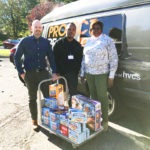 Members of HVCS' staff with the donation
