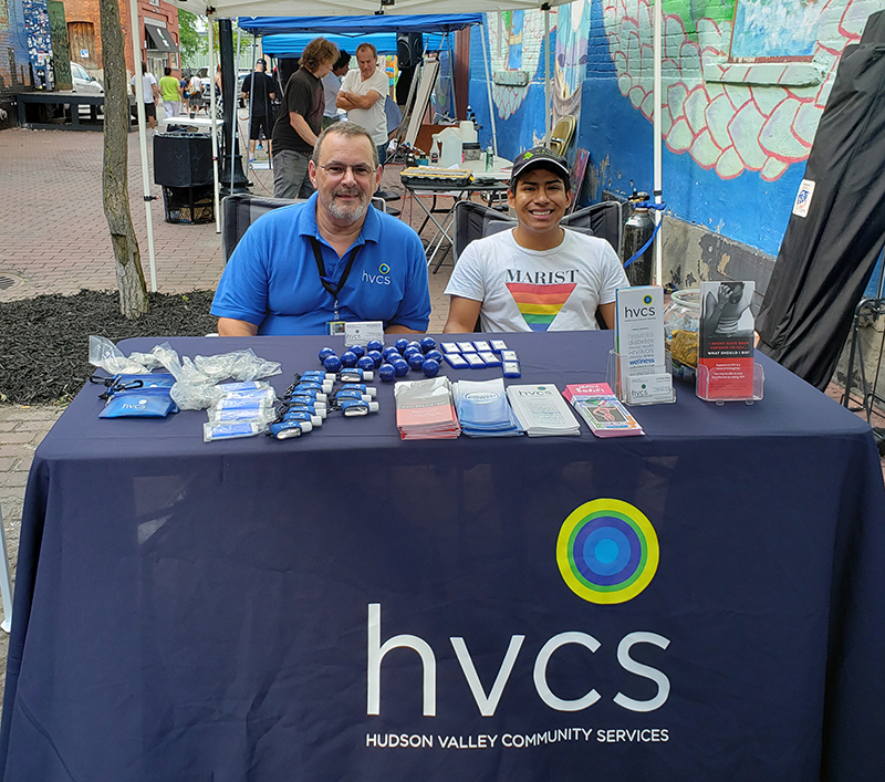 HVCS' Bob and Jovanny table at the O+ Festival in Poughkeepsie