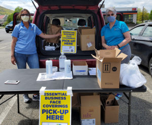 DCRCOC members distributing face masks to essential businesses
