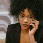 woman-in-black-blazer-talking-on-the-phone-3727462
